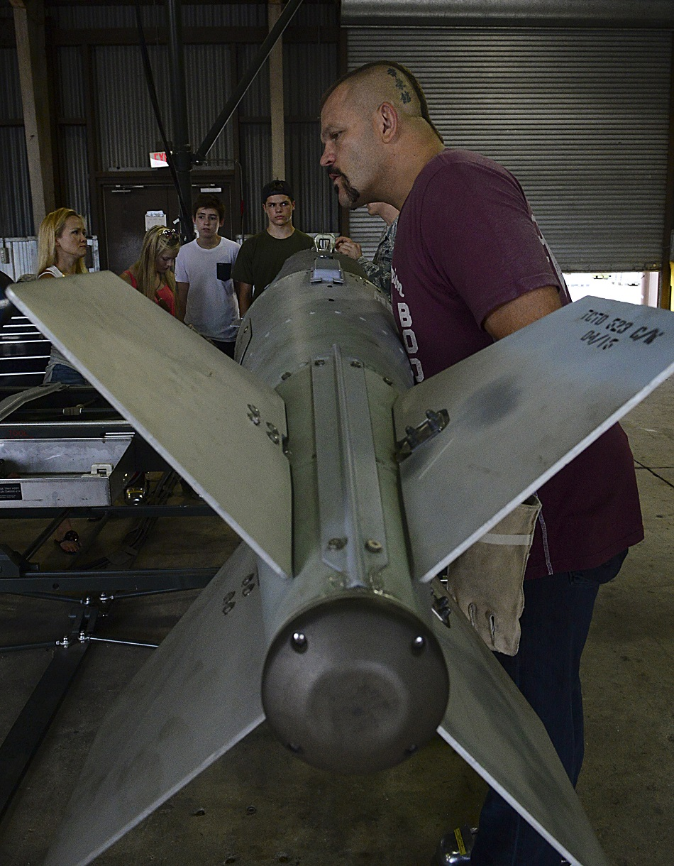 "Chuck ""The Iceman"" Liddell, retired American mixed martial artist, inspects a guided bomb unit-31 on Osan Air Base, South Korea, Aug. 5, 2015. Liddell is a former Ultimate Fighting Championship Light Heavyweight Champion. He has an extensive striking background in Kempo, Koei-Kan karate, and kickboxing, as well as a grappling background in collegiate wrestling and Brazilian Jiu-Jitsu. (U.S. Air Force photo/ Senior Airman Kristin High)"