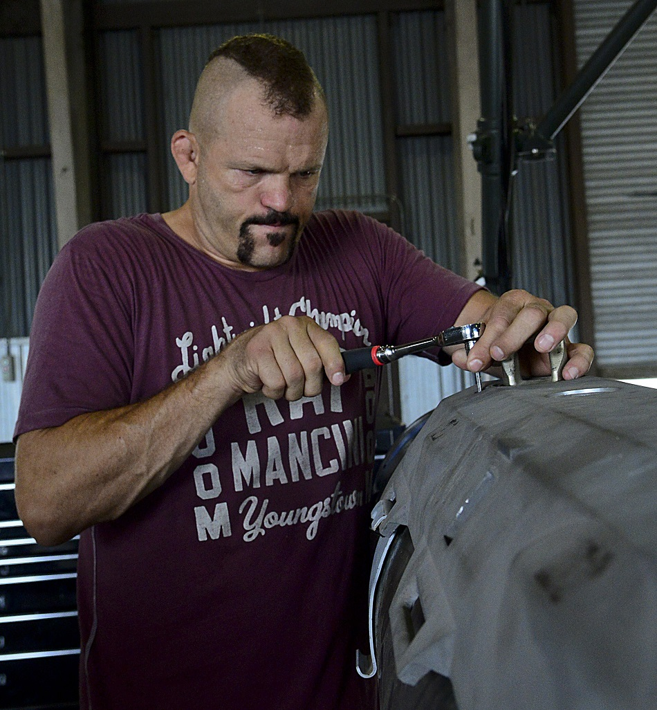 "Chuck ""The Iceman"" Liddell, retired American mixed martial artist, tightens a bolt on a guided bomb unit-31 on Osan Air Base, South Korea, Aug. 5, 2015. Liddell visited various units across the base during a morale trip. Liddell is a former Ultimate Fighting Championship Light Heavyweight Champion. He has an extensive striking background in Kempo, Koei-Kan karate, and kickboxing, as well as a grappling background in collegiate wrestling and Brazilian Jiu-Jitsu. (U.S. Air Force photo/Senior Airman Kristin High)"