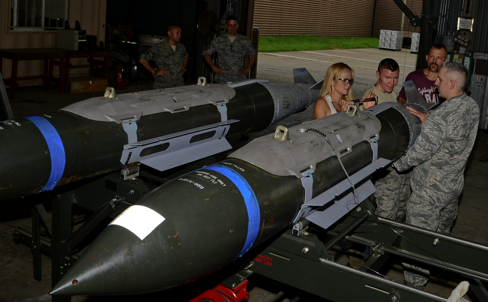 "Heidi Liddell, spouse of retired American mixed martial artist Chuck ""The Iceman"" Liddell, assists with assembling a guided bomb unit-31 on Osan Air Base, South Korea, Aug. 5, 2015. The Liddell family visited various base units for demonstrations and to meet-and-greet with the Airmen during a morale trip, including the fire department, the fitness center and the munitions section. (U.S. Air Force photo/Senior Airman Kristin High)"
