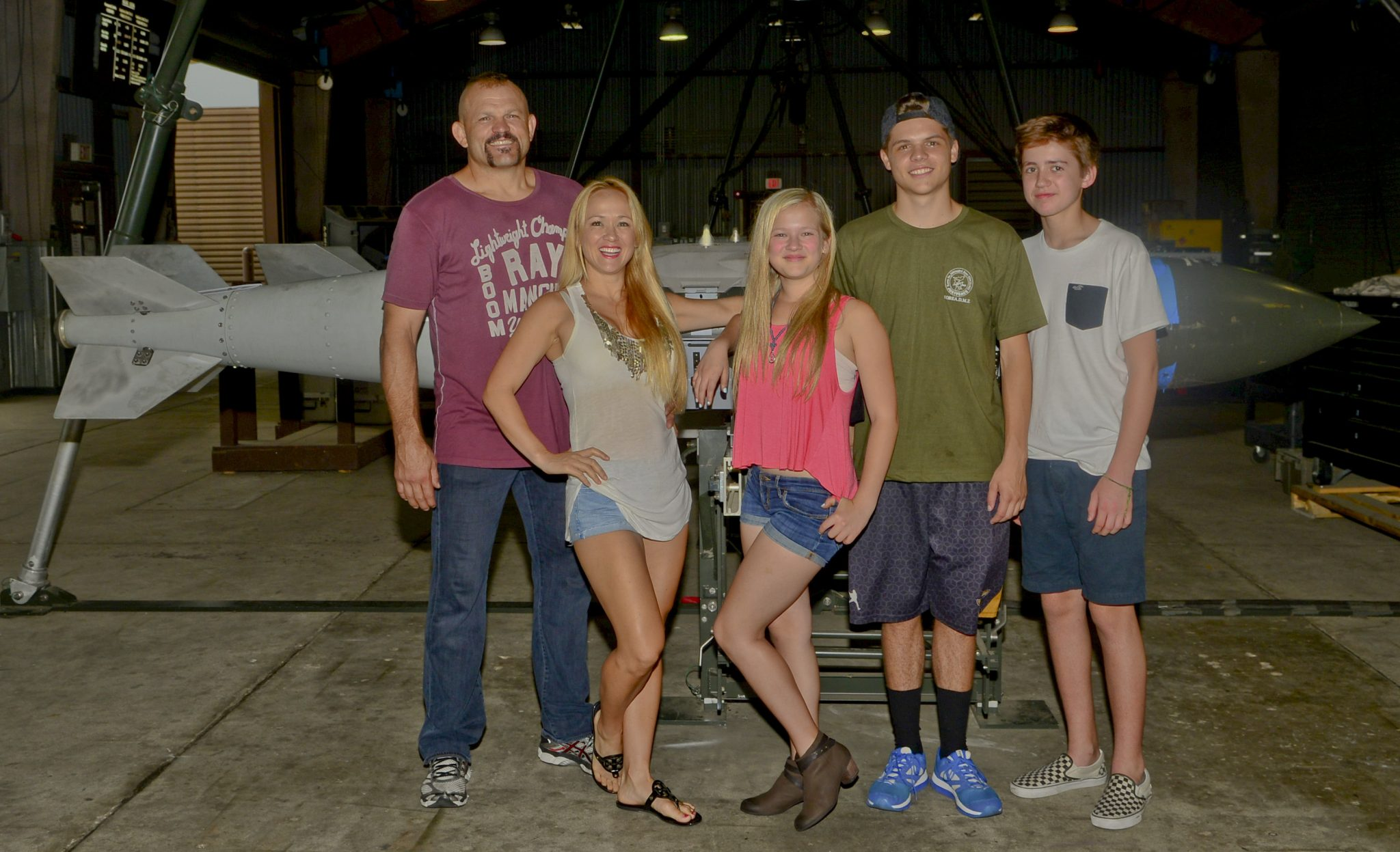 "The Liddell family poses for a photo on Osan Air Base, South Korea, Aug. 5, 2015. Chuck ""The Iceman"" Liddell, retired American mixed martial artist, and his family visited various units across the base including fire department, the fitness center, and the munitions section during a morale trip. Liddell is a former Ultimate Fighting Championship Light Heavyweight Champion. (U.S. Air Force photo/Senior Airman Kristin High)"