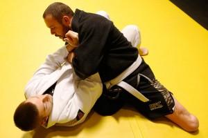 Joey Bozik practices with Justin Oberle during a Brazilian jiu-jitsu training session.