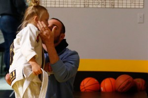 Joey Bozik kisses his daugher, Violet Bozik, after her training session at Tier 1 in McKinney.