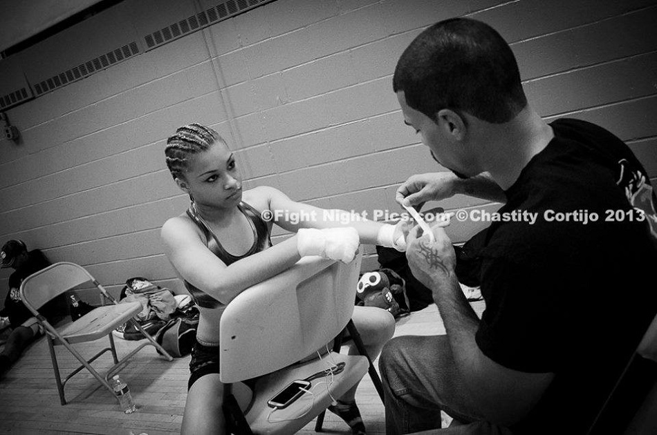 "Kai Malik Evers (right) wraps the hands of Destiny ""The Cage Cutie"" Quinones Photo by FightNightPics.com Chastity Cortijo"