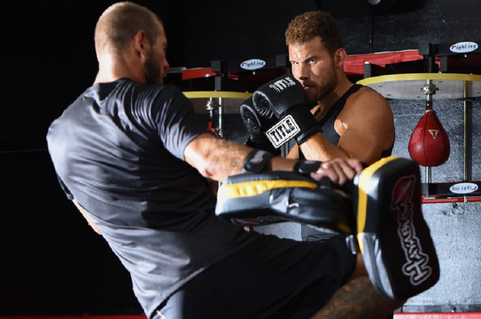"Can a ""Cowboy"" stop a Clipper in the ring?© John W. McDonough/Red Bull Content Pool Blake Griffin and Donald ""Cowboy"" Cerrone during the filming of ""The Crossover with Blake Griffin"" at Triton MMA Training Center in Redondo Beach, CA, USA, on 22 September, 2015."