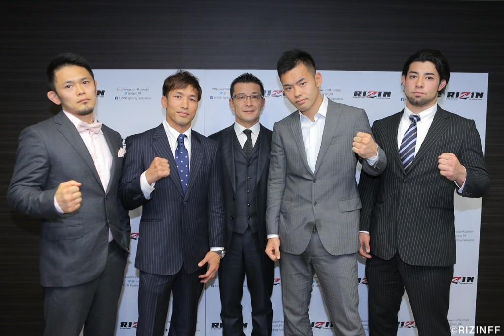 "RIZIN FF Chairman Nobuyuki Sakakibara (center) with fighters (from left to right) Akiyo ""Wicky"" Nishiura, Kazuyuki Miyata, Hinata Watanabe and Ken Hasegawa."