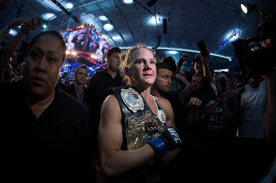 Holly Holm walks to the back after knocking out Ronda Rousey in epic fashion to win the women's bantamweight title at UFC 190 in Melbourne, Australia.