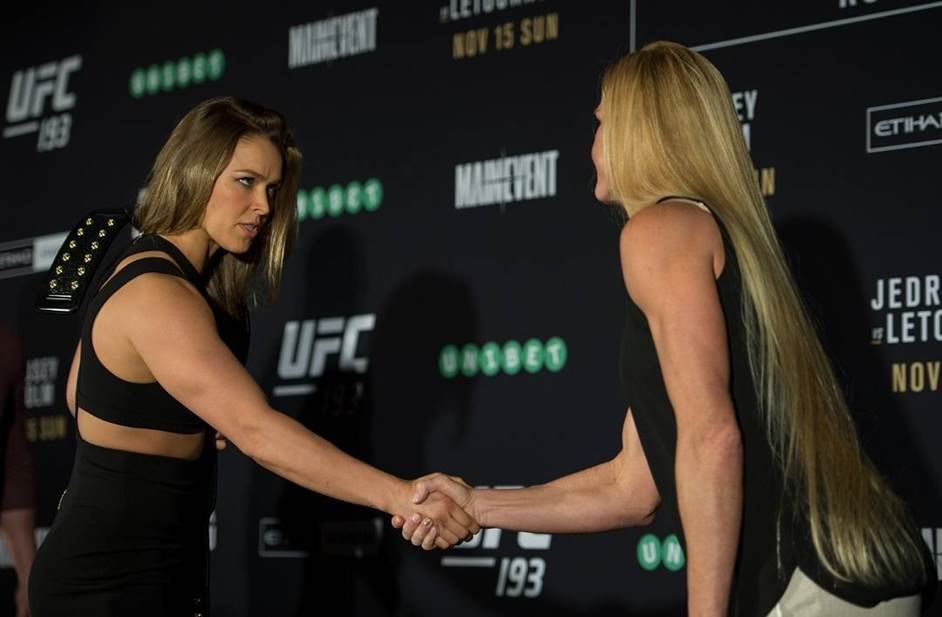 (L-R) UFC women's bantamweight champion Ronda Rousey of the United States shakes hands with Holly Holm of the United States during the UFC 193 Ultimate Media Day festivities at Etihad Stadium on November 13, 2015 in Melbourne, Australia. (Photo by Brandon Magnus/Zuffa LLC)