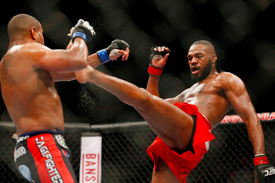 Jon Jones kicks Daniel Cormier during their light heavyweight title bout at UFC 182 in January. Photo: AP