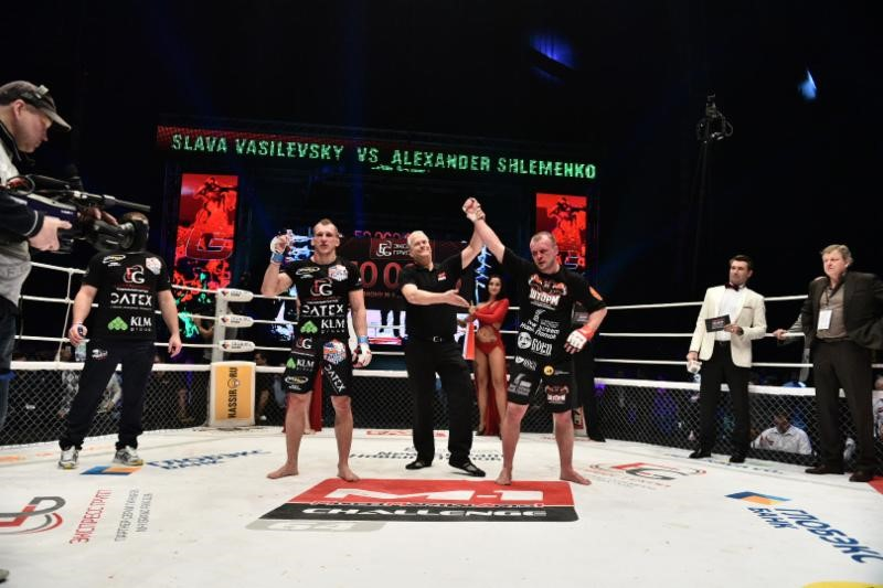 Alexander Shlemenko's hands is raised in victory after the decision was announced for his M-1 Global Grand Prix Middleweight Tournament semifinals match against Vyacheslav Vasilevsky