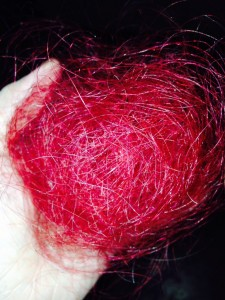 Racheal Blaze holds a patch of red hair that fell from her head.