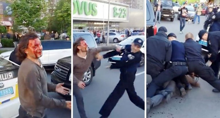 Former Olympic wrestler Vyacheslav Oliynyk fights off seven police officers. Photo courtesy of craziestsportsfights.com